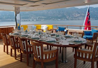 alfresco dining setup on the upper deck aft of luxury yacht OASIS