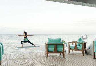 there's so much room on superyacht ramble on rose that guests can spend the majority of their time doing yoga to relax instead of anchoring at a marina where they are more susceptible to contracting coronavirus
