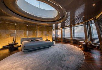 spacious master suite with full-length windows and skylight on board luxury yacht Savannah