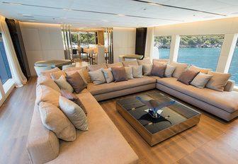 sumptous skylounge with U-shaped sofa aboard luxury yacht OURANOS