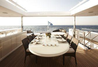 alfresco dining on upper deck aft aboard charter yacht E&E