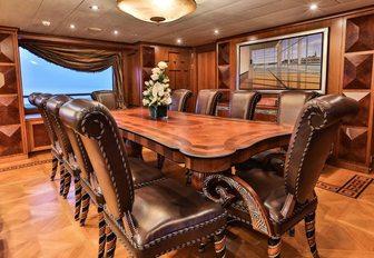 grand dining area in the main salon of motor yacht DENIKI