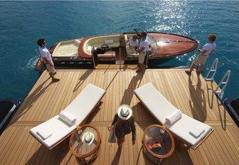 crew members on the swim platform of motor yacht AMARYLLIS prepare the limousine tender
