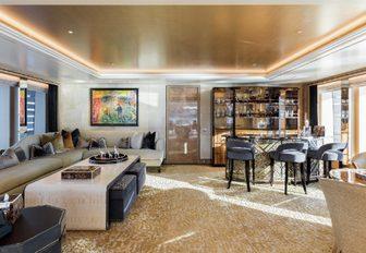 Irish whiskey bar and seating area in the main salon of charter yacht JOY