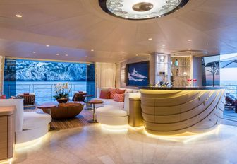 beach club with bar, seating and drop-down swim platforms on board motor yacht 'Here Comes The Sun'
