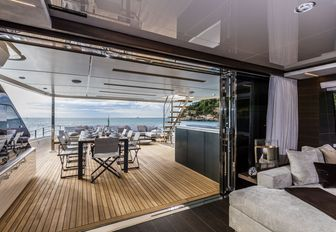 view of upper deck aft alfresco dining area from the skylounge aboard charter yacht December Six