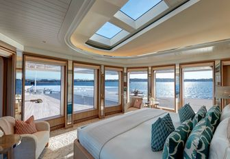 master suite on board motor yacht JOY with 270-degree views across expansive foredeck terrace