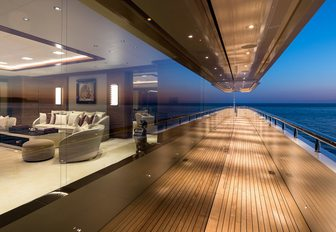 Side decks of Superyacht LANA with glass window showing interiors