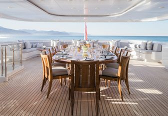 alfresco dining setup on the upper deck aft of superyacht TURQUOISE