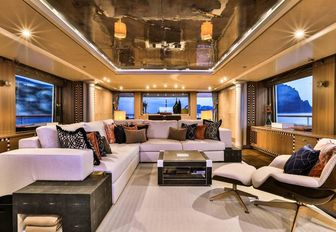 L-shaped sofa and armchair in the skylounge aboard motor yacht DENIKI