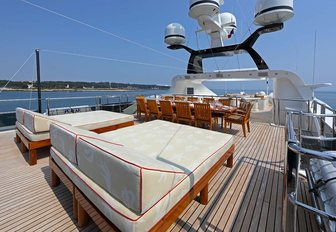 sun loungers and dining table on the sundeck of superyacht JAGUAR