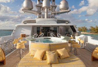 Jacuzzi with swim-up bar and sunpads on board luxury yacht My Seanna