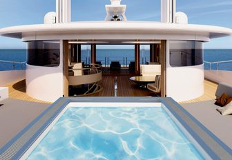large pool and under cover seating on the sundeck of superyacht Illusion Plus