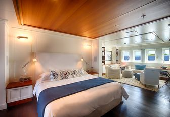 full-beam master suite with large bed and seating area on board luxury yacht SENSES