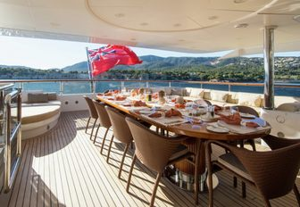 alfresco dining table on the upper deck aft of motor yacht DIANE