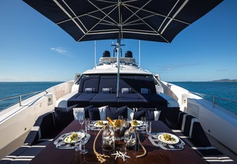 dining area and sunpads on foredeck of charter yacht Take 5