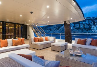 seating forms an alfresco lounge on the aft deck of charter yacht 'Here Comes The Sun'