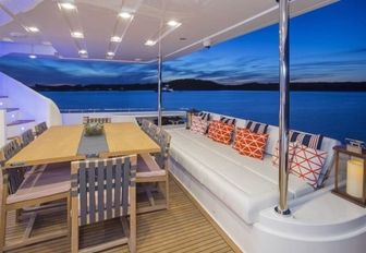 alfresco dining and lounge area on aft deck of motor yacht Alandrea