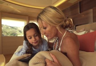 A mother and daughter enjoy the interior of luxury yacht Here Comes The Sun