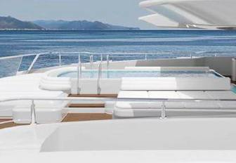 the swimming pool on the the large upper aft deck of superyacht O'Pari