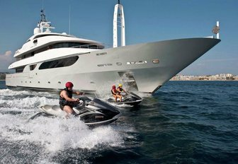 Guests on water toys with superyacht RARITY behind