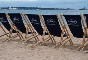 film festival deckchairs line a sandy beach in Cannes, France