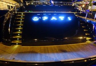 The lit-up stern of motor yacht O'PATI