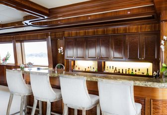 marble-topped wet bar in the skylounge of motor yacht Far From It
