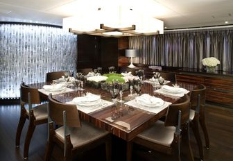 square dining table in the main salon aboard superyacht Inception