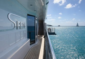 side deck and master suite's drop-down balcony on the main deck of charter yacht SIREN