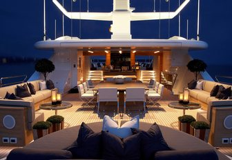 rotating sunbed, dining table and seating on the sundeck of luxury yacht SEALYON