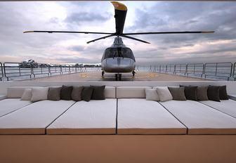 helicopter lands on helipad aboard luxury yacht Planet Nine
