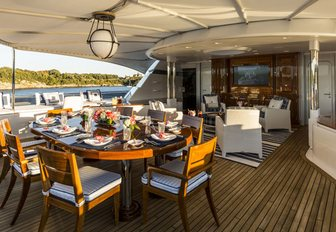 alfresco dining on the main deck aft of luxury yacht 'Blue Moon'