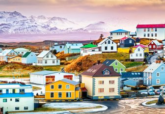 pastel village in iceland close to mountains