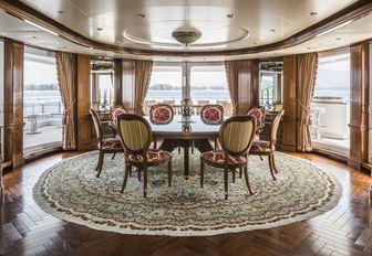 magnificent circular dining area on the bridge deck aft of motor yacht TITANIA