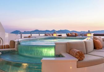spa pool with cascading waterfall feature lit up on the sundeck of luxury yacht Lucky Lady