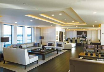the sleek main salon of charter yacht siren with discreet lighting and modern furnishings provides her guests with ample space to enjoy themselves when not on her impressive collection of water toys