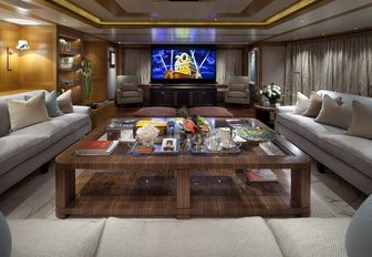 the spacious and modern styled main salon on charter yacht lady britt with grand seating arangement and flat screen tv