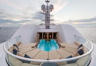 spa pool surrounded by sun pads on the sundeck of luxury yacht WHEELS