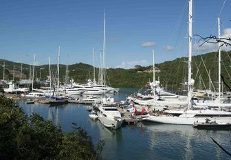 superyachts line up in an Antigua marina on a beautiful day