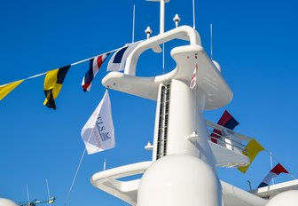 Superyacht with flags draped across it at Monaco Yacht Show 2018