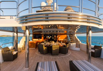 circular dining table on the upper deck aft of charter yacht Remember When