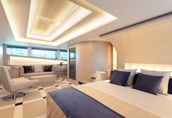 Cream styling in master suite of charter yacht Philmi with skylight
