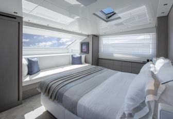 master suite faces large window on board charter yacht Dinaia