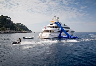 Superyacht BINA and her water slide on the water