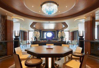 dining table in the main salon aboard motor yacht Barbara
