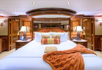 classically-styled master suite with large bed on board superyacht EXCELLENCE