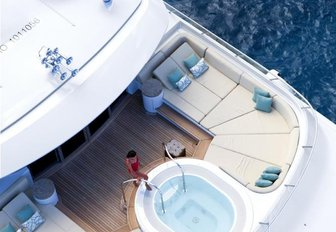 A charter guest enjoys the Jacuzzi on board superyacht Lady Britt