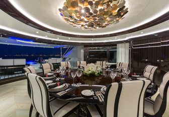 formal dining area in indoor-outdoor area on board motor yacht OKTO