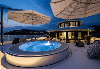 Jacuzzi and sunpads on the master suite terrace aboard motor yacht 11/11